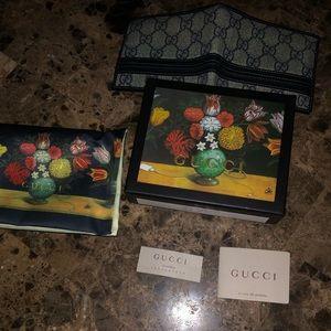 Blue Gucci Supreme wallet.